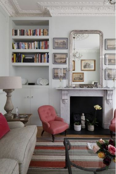 #SittingRoom | Overmantle #mirror with silvered #frame looks tall and elegant with #pictures either side.