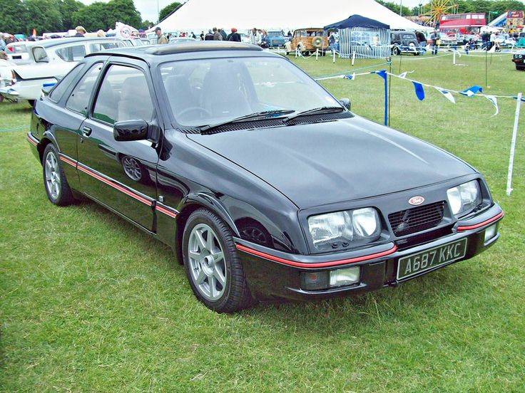 https://flic.kr/p/bm7748 | 213 Ford Sierra XR4i (1983) | Ford Sierra XR4i (1983-85) Engine 2792cc V6 OHV  Production 27,400 Registration Number A 687 KKC FORD (EU) SET www.flickr.com/photos/45676495@N05/sets/72157623665118181... With distinctive bi-plane rear wing and powered by a 2.8ltr V6 of 150bhp, the suspension was stiffened and the spoiler conquered cross wind instability. But with only rear wheel drive handling could be a challenge Shot at The Enfield Pagaent 30.05.2010 Ref 69-213…