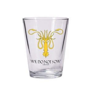 Dark Horse's line of glassware features the house sigils from HBO's award winning television series Game of Thrones. The A Game of Thrones Greyjoy Sigil Shot Glass features a clear glass design and bears House Greyjoy's kraken sigil and slogan.