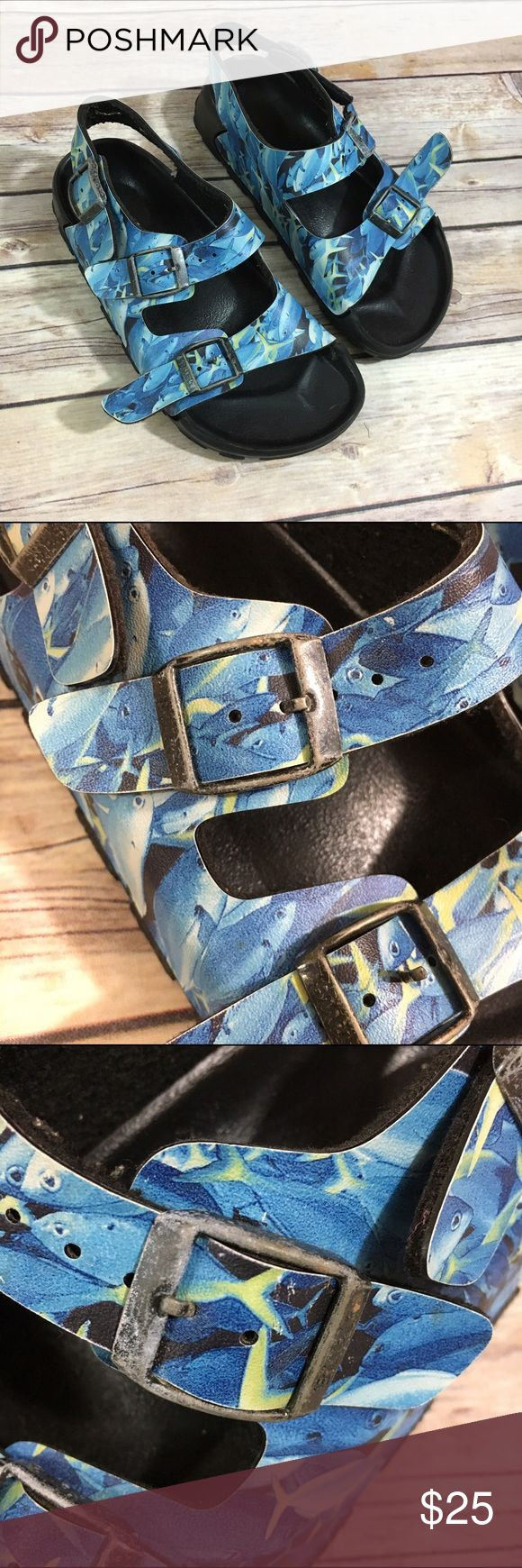 """Birkis Birkenstock Blue Fish Sandals Birko Flor 32 Birkis Birkenstock Blue Fish Sandals Birko Flor Blue Fish 32  These are a 32 which Birkenstock says is a 1-1.5 kids.  Good to very good used condition.  These have been worn but were definitely not the """"everyday favorite"""" shoe.  :)  At least two more kids wear left in them, for sure.  Buckles show more wear than the rest of the shoe, in my opinion.  Super cute fish print.  #birkis #birkoflor #sandals #blue #fish #black #birkenstock…"""