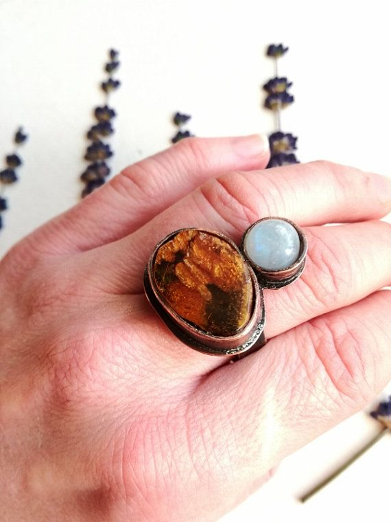 Check out this item in my Etsy shop https://www.etsy.com/listing/471759077/moonstone-amber-ring-statement-ring