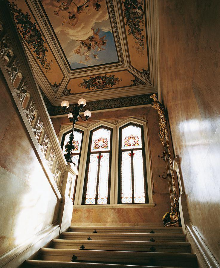 View of grand staircase of Villa Feltrinelli. #lake #garda #grandhotel #villafeltrinelli #staircase #fresco #windows