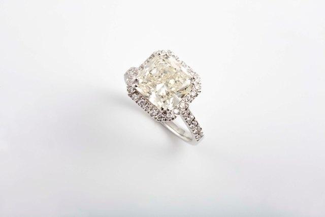 5ct Radiant cut diamond ring - with small diamonds.