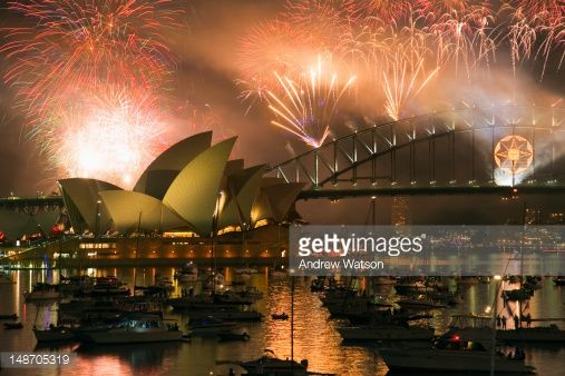 Stock Photo : New Year's Eve fireworks exploding over Sydney harbour, from Mrs Macquaries Point.