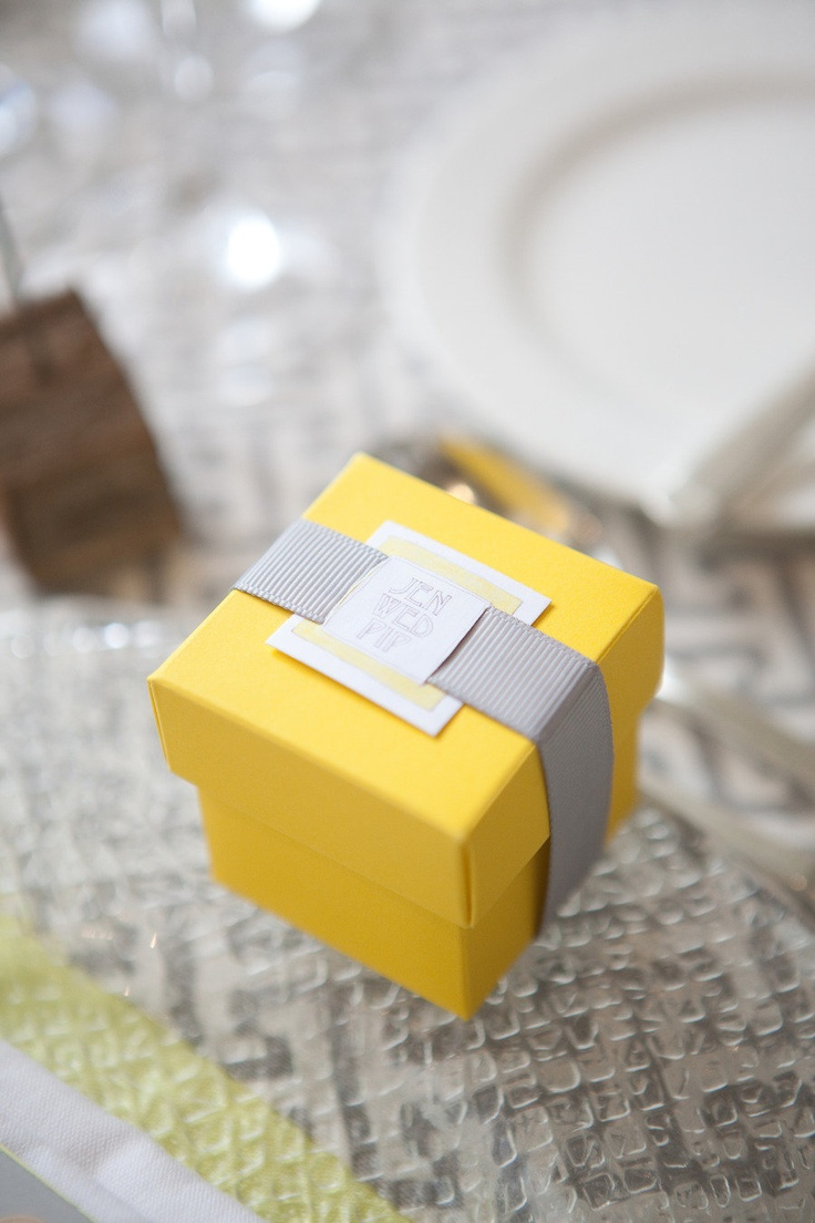 Yellow and grey favor boxes