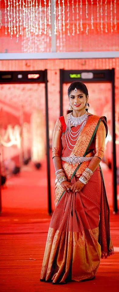 South Indian bride. Diamond Indian bridal jewelry.Temple jewelry. Jhumkis.Red silk kanchipuram sari.Braid with fresh jasmine flowers. Tamil bride. Telugu bride. Kannada bride. Hindu bride. Malayalee bride.Kerala bride.South Indian wedding.