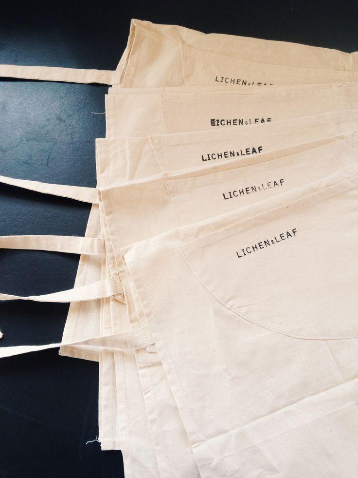 Preparing aprons for the Lichen & Leaf Block Printing Workshop. http://lichenandleaf.com/pages/workshops