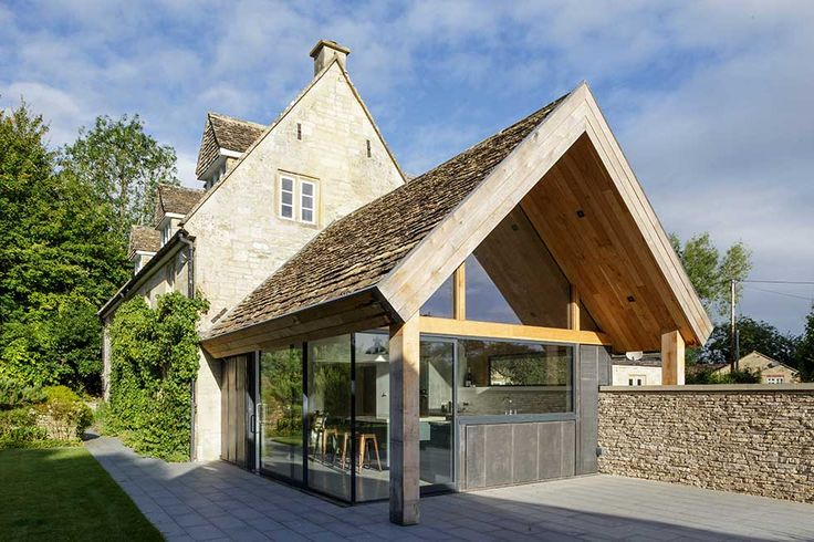A contemporary extension to a Grade II listed 18th-century home combines traditional materials with clever, contemporary details