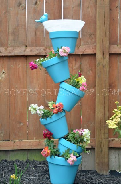 For my garden... I'll make it...  paint the pots (color of choice) or do terra cotta drill holes in the bottoms, place pipe through the center... and get rid of the bird bath thing and definately do some ivy to have the hanging over flowing look with the flowers...  awesome!