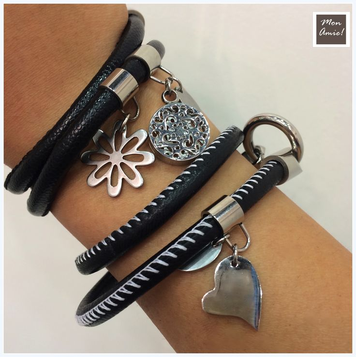Black bracelets with metal flower, heart and circle.