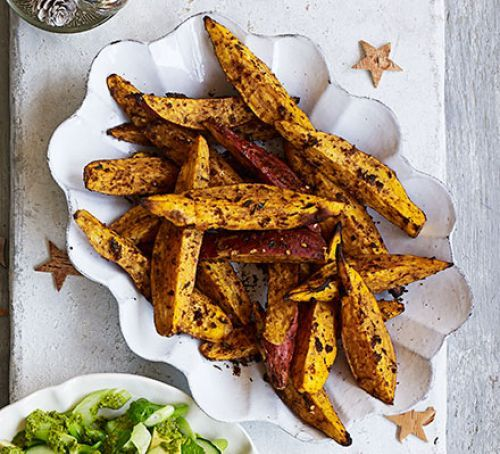 Spiced sweet potato wedges | Toss sweet potato in cumin, chilli and sumac, then oven bake with lemon and garlic for chunky chips which are crispy yet fluffy