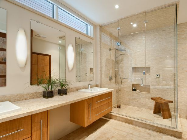 Accent Tile Custom Millwork Glass Shower Glass Walls Limestone Mosaic Niche Recessed Lighting Shared Bathroom Shower Bench Tile Floor Shower Walls Vanity