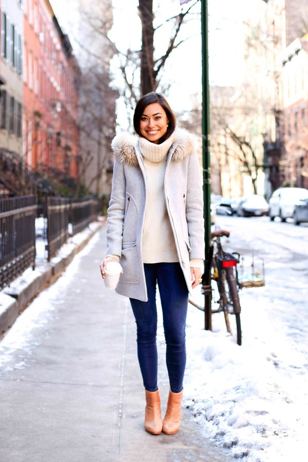 Stay chic in the cold with a fur collar and a chunky turtleneck sweater.