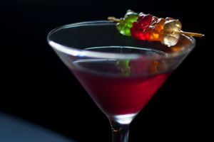 The Gummi Bear Margarita is a candy-like cocktail recipe that mixes raspberry tequila with watermelon, cranberry, and gummy bears that is fun to drink.