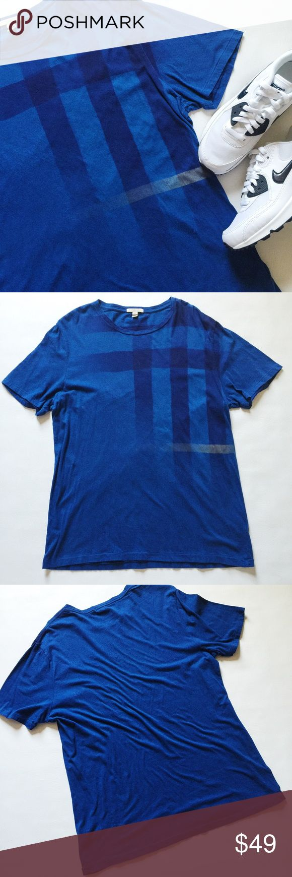 """Burberry Abstract Check Graphic Tee Burberry Abstract Check Tee in royal blue featuring iconic graphic print.  Sporty and casual!  Pre-loved but in excellent condition.  No holes, stains or damage.  Size XXL but runs smaller like a L.  Please verify measurements to ensure correct fit.  Measurements laying flat: Armpit to armpit: 22"""" Waist (across): 20"""" Total length: 29.5""""  Sleeve length: 9.5"""" Burberry Shirts"""