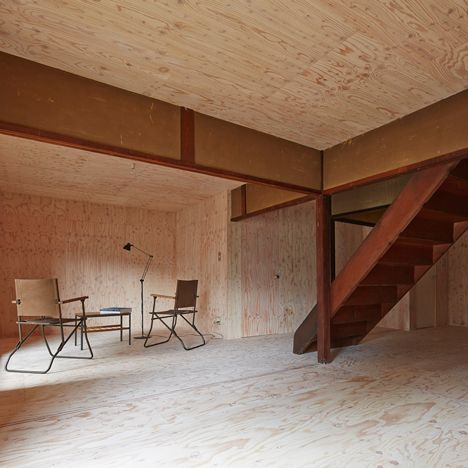 NAAD has gutted a 100-year-old house in Kyoto, re-skinning the interior in plywood to create a temporary dwelling that is designed to look incomplete