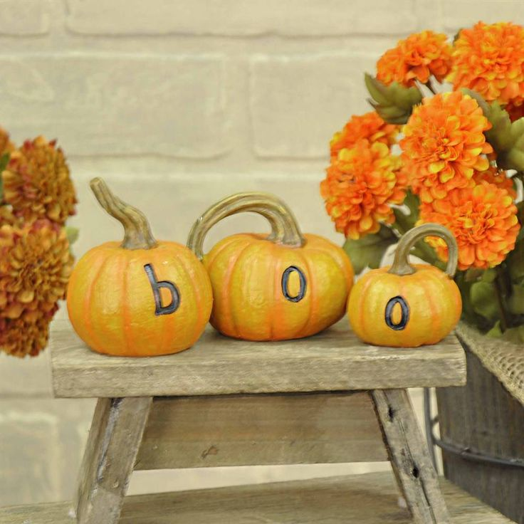 set of three resin orange boo pumpkins largest is x find this pin and more on country halloween decor