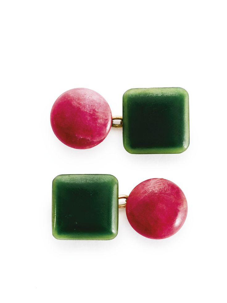 A pair of Fabergé gold and carved hardstone cufflinks, workmaster Erik Kollin, St. Petersburg, 1899-1901 the links formed as a square of nephrite and a rhodonite disc with gold mounts and chains, struck with workmaster's initials, 56 standard, scratched inventory number 66472 width 7/8 in. (2.3 cm)