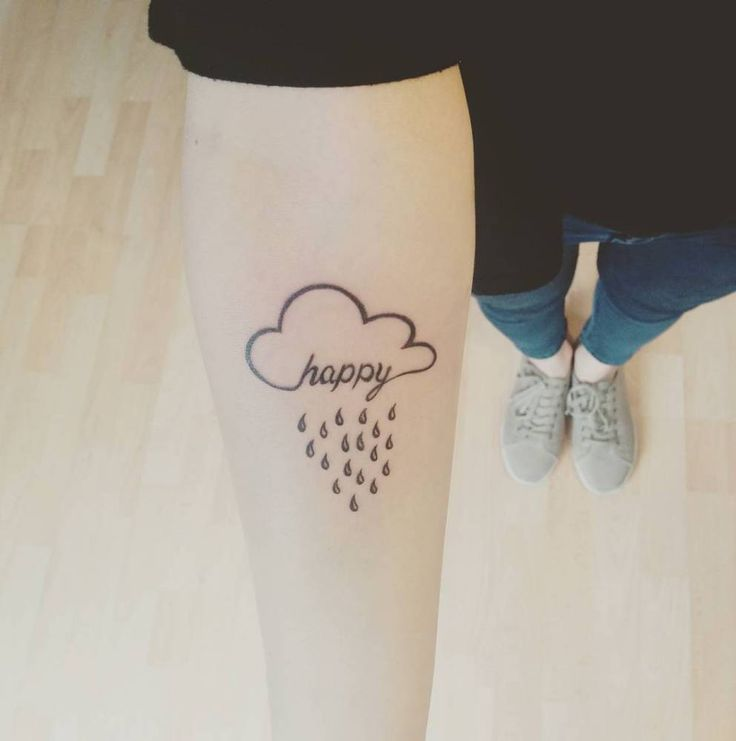 """Happy"" cloud tattoo on the right inner forearm."
