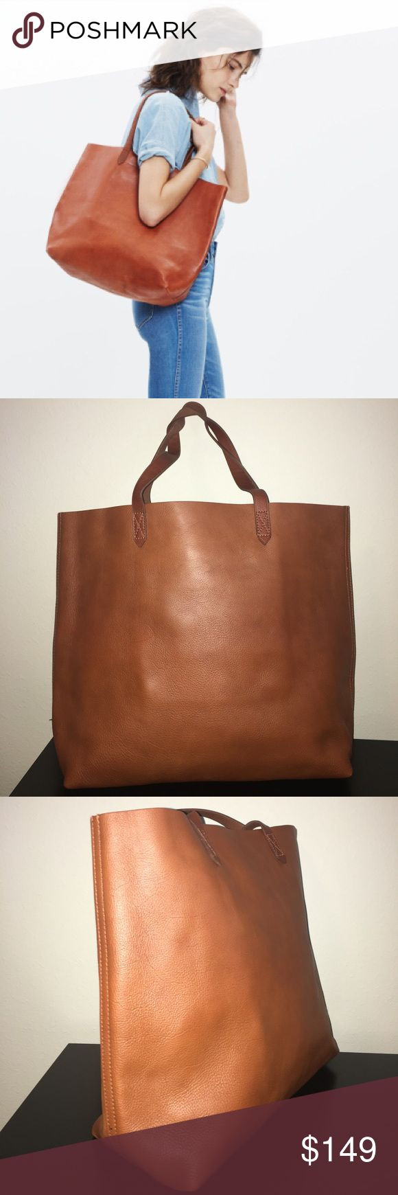 """New Madewell Transport English Saddle Tote Bag What goes into Madewell's signature tote? 2 pieces of fine leather are used for the body. 8 inch strap drop: long enough to sling over your shoulder, but short enough to hold as a top handle.   Made of vegetable-tanned leather that burnishes with wear into a beautiful patina. Please note this : As it is made of a natural material, each bag varies slightly in texture, markings and color. Interior zip pocket. Unlined. 8 1/4"""" handle drop. 14""""H x…"""