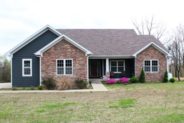 Beautiful Hardy siding and stone veneer home on the outskirts of town, sitting on 3.56 acres. This 3 bd, 2 bath home features a large master suite with his/her sinks, stand up tile shower, jet tub and large walk-in closet. The spacious kitchen features a breakfast nook, custom backsplash and pantry closet. Bedrooms are split,with 2 other bedrooms on other side of home.Living area includes custom gas log stone veneer see-through fireplace to dining room.Stunning hardwood floors in Poplar…