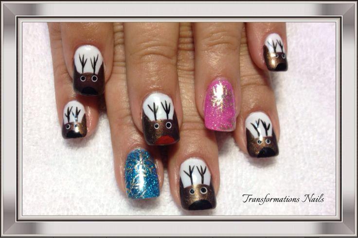 #reindeer nails #snowflake nails  #christmax nails #art #nails by #transformations Nails. #black prink nails #freehand  #nail art #funky nail #prink nails #blue nails #sparkle nail.