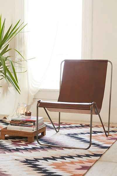 $329 comes in black as well. Express ship avail. Maddox Leather Sling Chair - Urban Outfitters