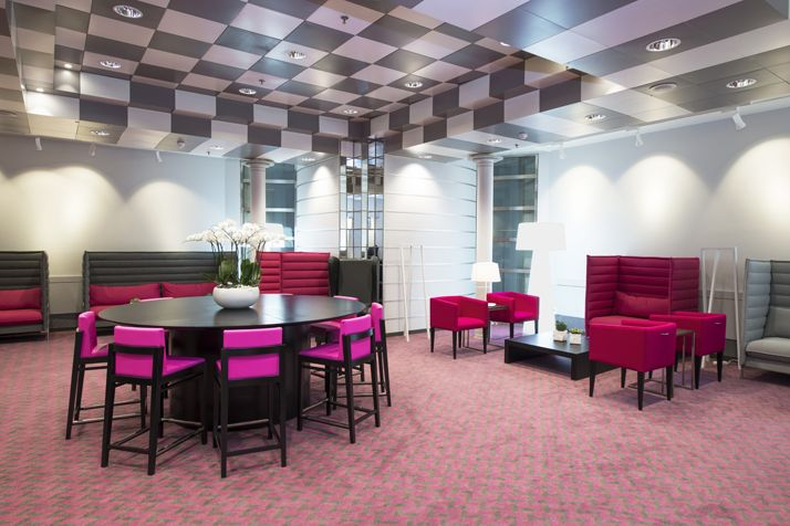 The hot pink and grey Business Lounge. Interior architecture | Ramsoskar