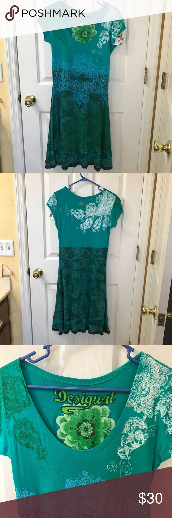 NWT Desigual Dress NWT Desigual Green Dress, size USA M (they run small, stretchy material) beautiful patterns all over Dress, see pics. I have misplaced belt but a rope or ribbon would work great with this dress! Desigual Dresses