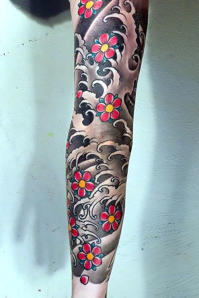 A tattoo sleeve of Japanese gray water inked on the arm of a guy. Style: Oriental. Color: Gray. Tags: Nice