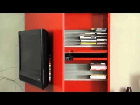 Composizione Link Box con porta tv RACK (modello depositato).   Laccato rosso e laccato inverno.  Sistema porta TV orientabile a piacere. Contenitore-base capace di nascondere lettori DVD, decoder, videoregistratori, fili e prese, dotato di sensore per poter gestire con il telecomando ogni funzione di tutti gli strumenti high tech.   L.390 h.188 p.61 completamente personalizzabile per dimensioni e finiture.