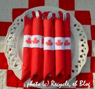Simple red paper napkins with printed maple leaf band.