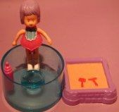 "2 1/2"" tall doll with her sandbox.  Blue stand does not come with the doll...just a prop."