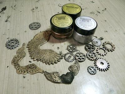 Friendly plastic embellishments coloiured with black gesso and gilding wax.