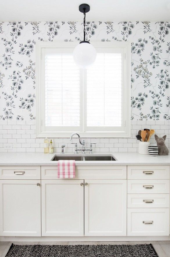 Before and after: see how a nondescript kitchen can get a feminine-chic makeover with floral wall paper, updated faucets and painted cabinets.