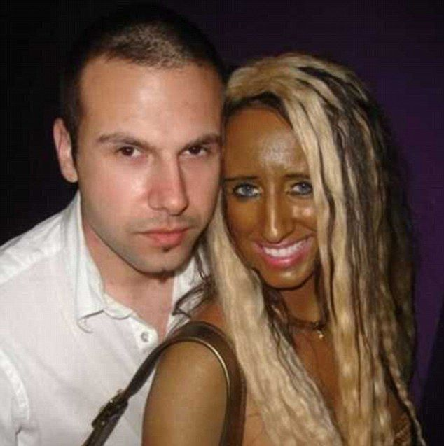 Is that really the look you were going for? This woman's epic fail in attempting to get a bronzed look has left her looking rather comically dark, as she is pictured cosying up for a photo with a male companion