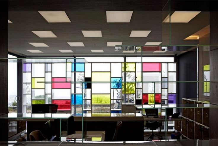 Ergoform Office installation for Spanish Farm 2013 A Piet Modrian  inspired bookcase to create a splash of colour against the glazing