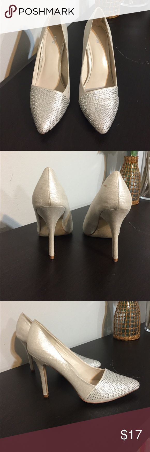 "Gorgeous sparkly toed heels Champagne colored heels with sparkly rhinestone toes. These were only worn once. There are two small scuff marks on the inside of the right shoe. From a pet and smoke free home. Heel height is 4"". Apt. 9 Shoes Heels"