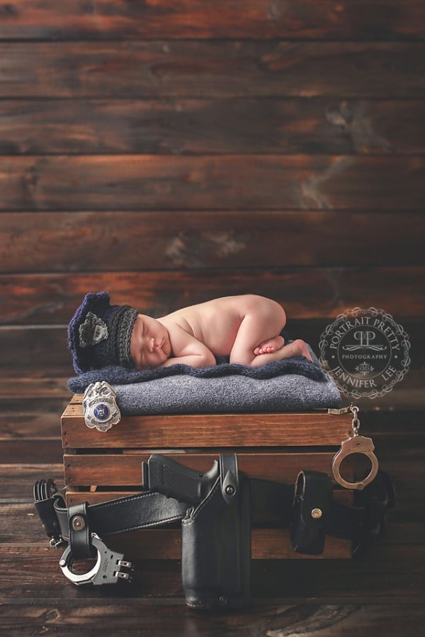 Newborn Police officer theme with Daddy's gear, by Portrait Pretty Photography a buffalo baby photographer servicing all of WNY in-studio or on-location for posed or lifestyle offering Newborn Photography Buffalo