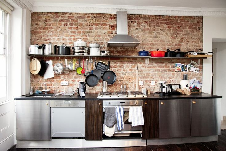 not exactly my style but i like the idea of a tile wall and hanging pans in a kitchen :)