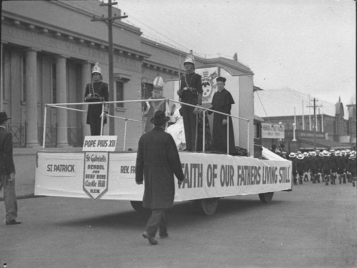 'Faith of our fathers living still'. The St Gabriel's School for Deaf Boys float heads into the Sydney Showground in the St Patrick's Day parade, 11 March 1939. Sam Hood Collection, Mitchell Library, State Library of New South Wales: http://www.acmssearch.sl.nsw.gov.au/search/itemDetailPaged.cgi?itemID=24640