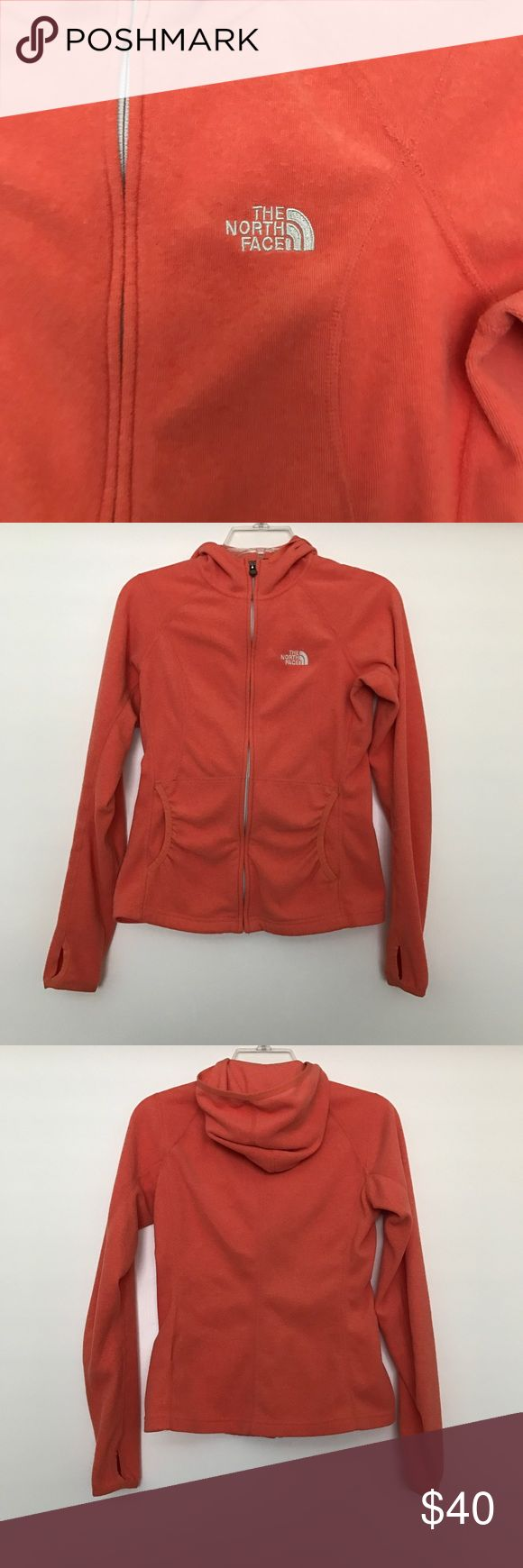 "The North Face women's Polarartec Classic sweater The North Face Polarartec Classic zip up sweater coral orange color very soft. size XS excellent condition  chest 17"" waist 14"" sleeve length 26"" sweater length 23"" (smoke free pet free home) The North Face Sweaters"