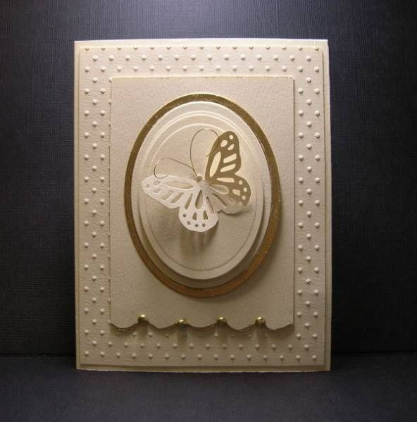 simple, clean, many layers with a butterfly...all white card except one gold accent layer on this card...
