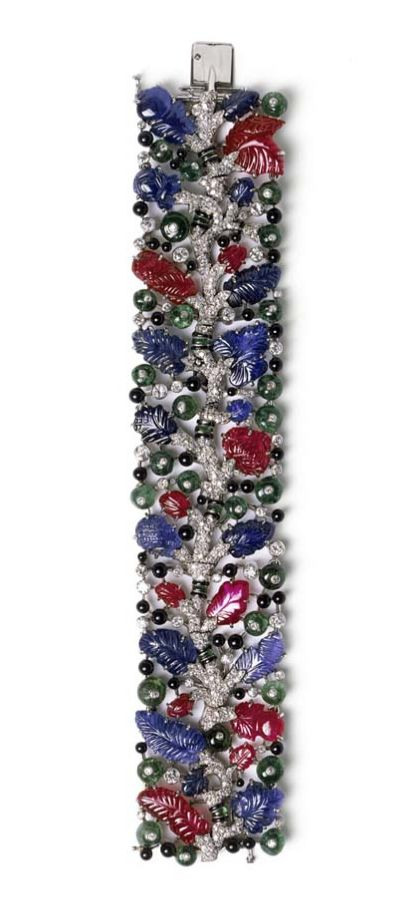 With its vivid coloured stones, including leaf-shaped carved sapphires and rubies, this Cartier bracelet from 1925 is designed in the famous Tutti Frutti style.