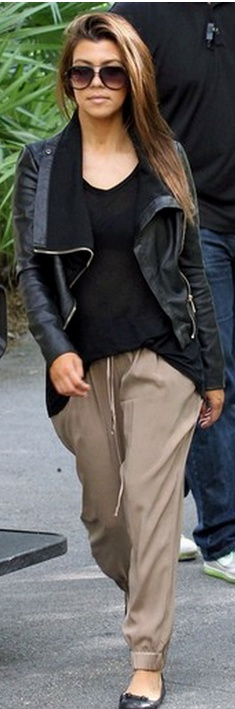 Who made  Kourtney Kardashian's black leather jacket, black ballet flat shoes, and brown pants that she wore in Miami?