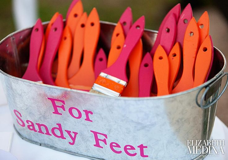 Cute idea for a beach wedding.  Brushes to wipe the sand off feet... Or a bucket like Auntie Marion :)