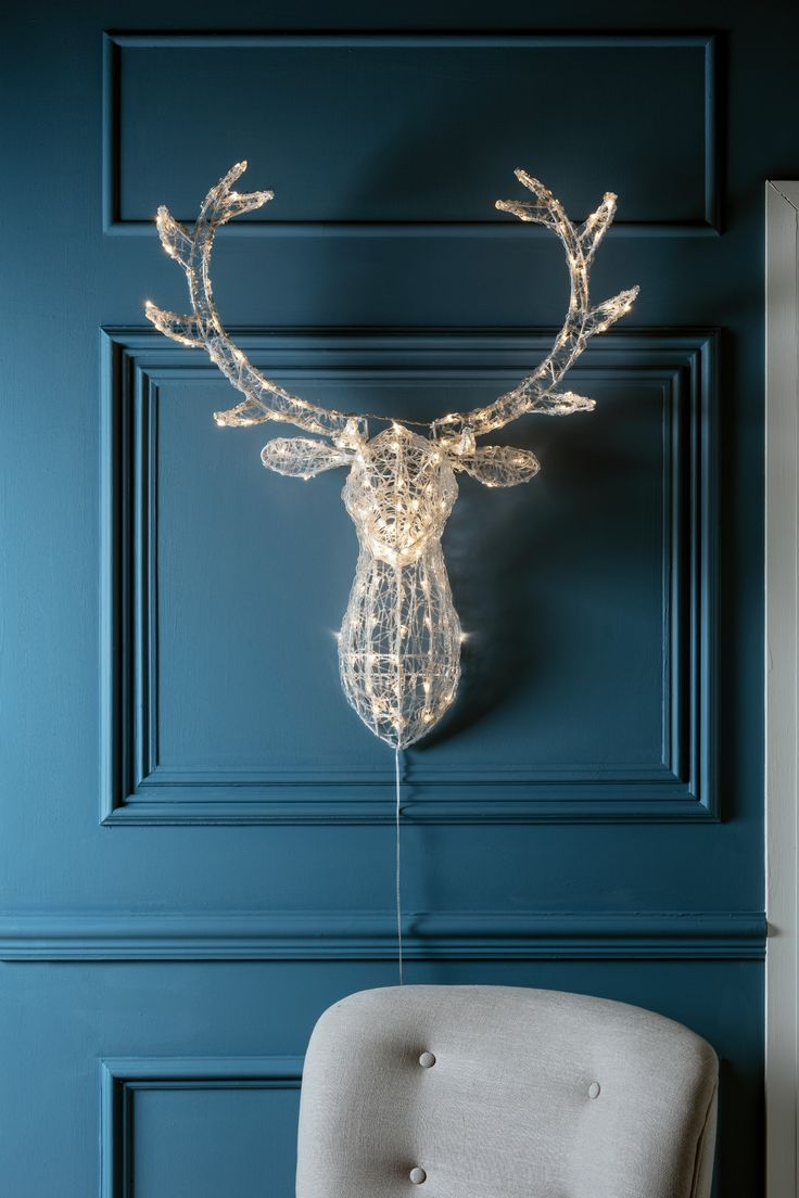 Introduce a magical winter wonderland to your home with our spun sparkling stag head. Pop in porches, above fireplaces or in entranceways, this mounted wall light introduces a warm white glow and striking feature wherever it goes!