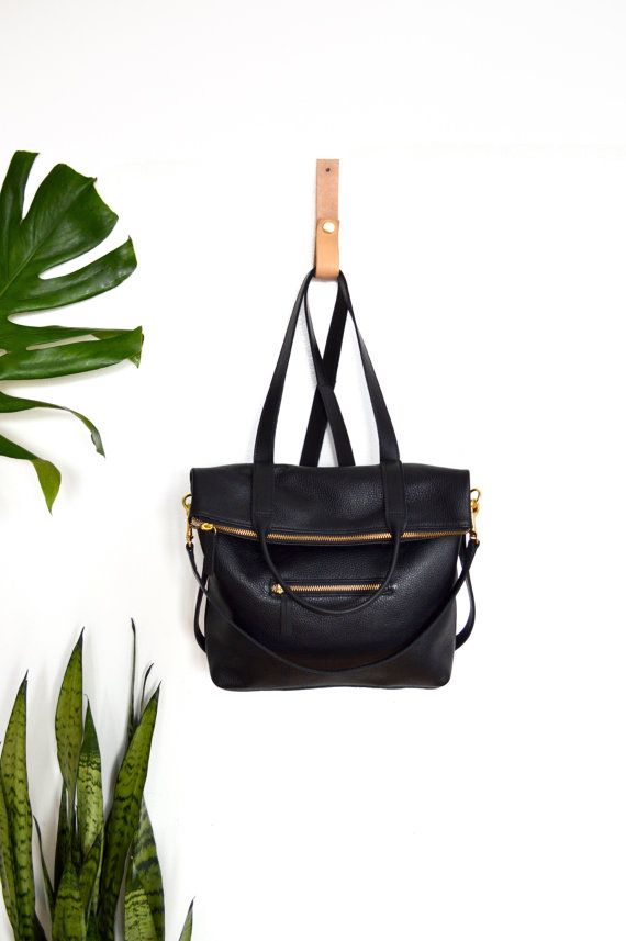 Leather Backpack Convertible 3-in-1 MABEL PACK A 3-in-1 bag! The Mabel pack can be worn as a backpack, a shoulder bag, or carried as a tote. 14.5 in tall when extended 10.5 in tall when worn with top folded 13.5 in wide opening 5 in deep Backpack straps are adjustable Front zip pocket