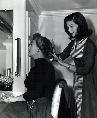"Joan Crawford getting her hair ""fixed"" by Pier Angeli - actresses of the Silver Screen."