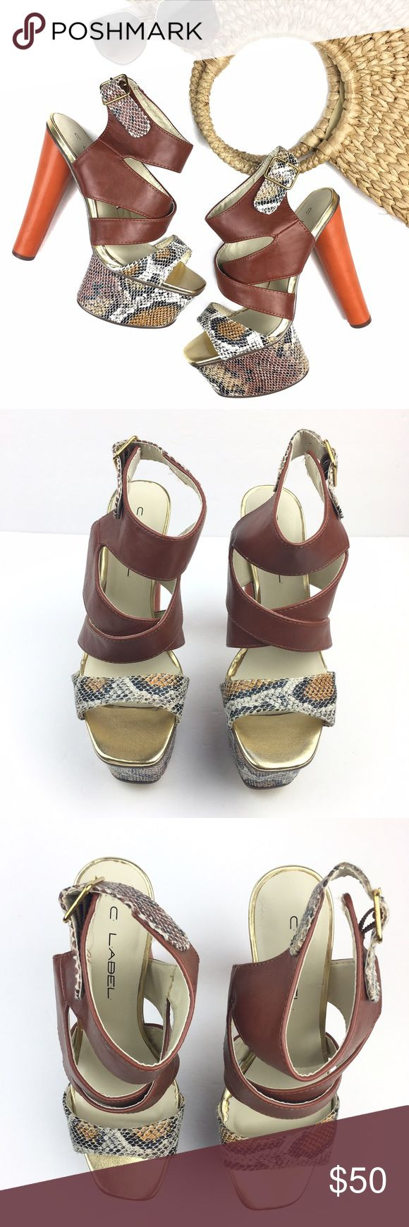 "NWOB Brown Orange Snakeprint Platform Heel Sandals These babies are to die for! These stunning open toe heeled sandals feature an orange 5.5"" heel, a 2"" snake print platform and camel crissscross ankle straps. NWOB, excellent condition. Run true to size. C. Label Shoes Heels"